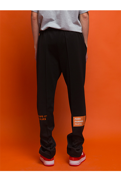 BACK PRINTED TRACK PANTS (BLACK)